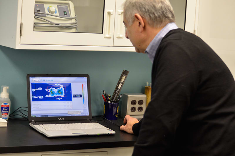 Ted Lazakis looks at pressure mapping results in Alpha Tekniko's R & D lab.