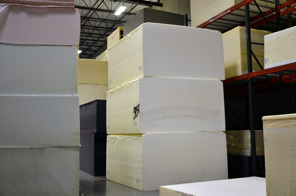 Buns of uncut foam, in various weights and densities, are ready to be transformed into custom products at Alpha Tekniko.